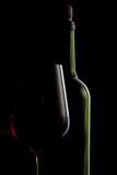 Red wine in glass and bottle on black royalty free stock photo