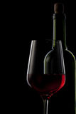 Red wine in glass and bottle on black Stock Photo