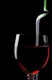Red wine in glass and bottle on black Stock Photography
