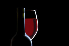 Red Wine Glass and Bottle on Black Royalty Free Stock Image