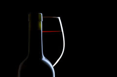 Red Wine Glass and Bottle on Black Stock Photo