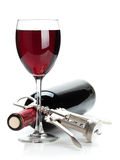 Red wine glass, bottle and corkscrew Stock Photo