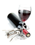 Red wine glass, bottle and corkscrew Royalty Free Stock Photography