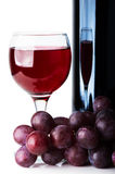 Red wine in glass, bottle Stock Photography