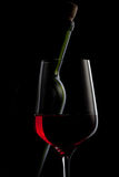 Red wine in glass and bottle isolated on black Stock Images
