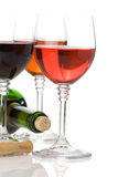 Red wine in glass and bottle on white Stock Photos