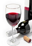 Red wine glass and bottles Royalty Free Stock Images