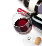 Red wine glass and bottles. Red wine, isolated, white background, top view, studio shot Royalty Free Stock Images
