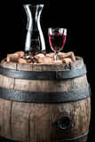Red wine glass and carafe on old wooden barrel Royalty Free Stock Image