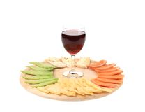Red wine glass and cheese table. Stock Photo