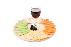 Red wine glass and cheese table. Royalty Free Stock Image
