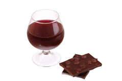Red wine glass and chocolate isolated. Red wine glass and chocolate over a white background Stock Images