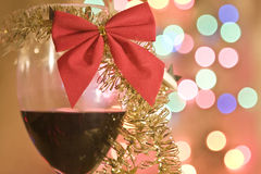 Red wine in glass with christmas tinsel  Stock Photo