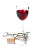 Red wine glass, cork and corkscrew Stock Image