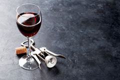 Red wine glass and corkscrew Stock Image