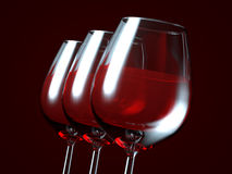 Red wine in a glass. On dark background Royalty Free Stock Images