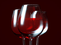 Red wine in a glass. On dark background Royalty Free Stock Photo