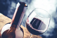 Red wine glass and decanter. Red wine glass and bottle - fine wine tasting concept Stock Images
