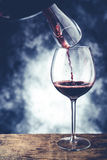 Red wine glass and decanter. Fine wine tasting concept Stock Image