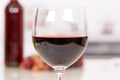 Red wine in a glass. Drink alcohol royalty free stock images