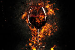 Red wine glass in fire Stock Images