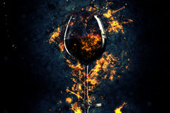 Red wine glass in fire Royalty Free Stock Photos