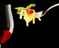 Red wine glass and fork with spaghetti Stock Images