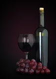 Red wine in glass with grapes and bottle Stock Photo