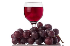 Red wine in glass and grapes Royalty Free Stock Photography