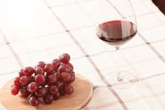 Red Wine in Glass with Grapes on The Table Stock Images
