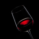 Red wine in glass isolated on black Royalty Free Stock Photography