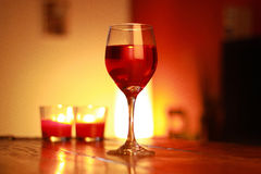 Red wine in glass with a living room background Royalty Free Stock Photography