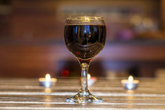Red  wine glass  in mood lighting. Royalty Free Stock Images