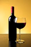Red wine glass near bottle Royalty Free Stock Images