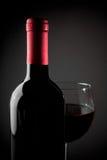 Red wine glass near bottle Stock Photo