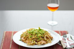 Red wine glass and pasta, spaghetti with avocado Stock Image