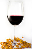 Red wine. A glass of red wine with peanut Stock Image
