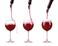 Red wine in glass pouring from bottle and make splash, dispenser on the bottle, red wine jet Stock Photography