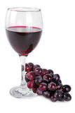 Red wine glass with red grapes Stock Photo