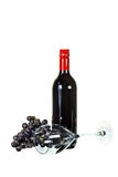 Red wine with glass and red grapes isolated on white background Royalty Free Stock Photo