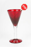 Red wine glass and sign stop. On a white background Royalty Free Stock Photo