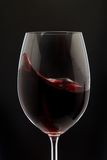 Red Wine Glass silhouette on Black Stock Photography