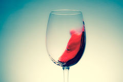 Red wine in glass, splashing, splash, wave of red wine close up Royalty Free Stock Photo