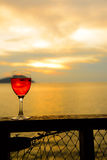 Red wine glass at sunset Stock Image