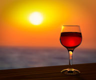Red wine glass at the sunset. Red wine glass at the summer sunset romantic background Royalty Free Stock Photography