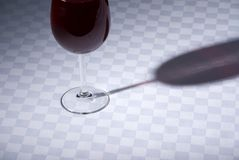 Red wine glass on table Stock Images