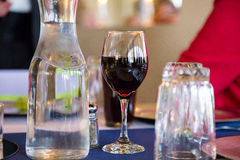 Red Wine in Glass on Table Royalty Free Stock Images