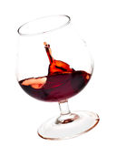 A red wine glass about to fall Royalty Free Stock Photos