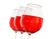 Red wine in a glass. On white background Stock Photography