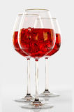 Red wine in a glass. On white background Stock Image